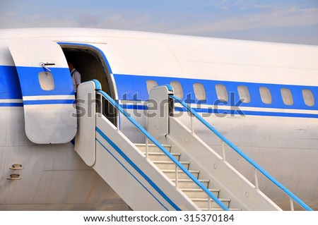 Entrance to the plane - stock photo