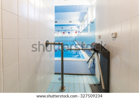 Entrance to the pool,  with electronic turnstile.  - stock photo