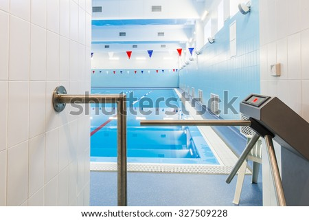 Entrance to the pool,  with turnstile.
