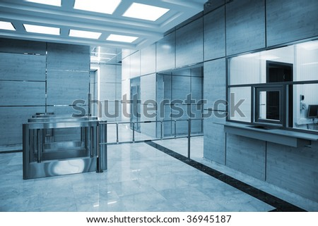entrance to the turnstile in a modern building - stock photo