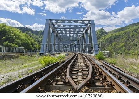 Entrance view of steel railway bridge - stock photo