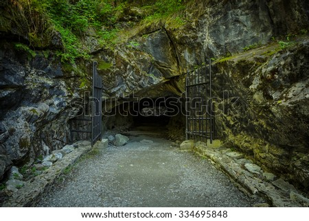 entrance with gates to the underground tunnel - stock photo