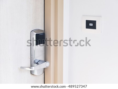 Entrance wood door with electronic keycard lock system and bell button