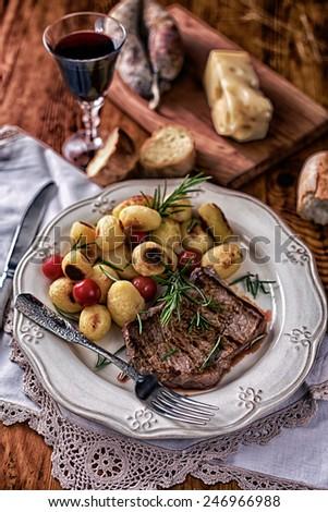 Entrecote with potatoes - stock photo