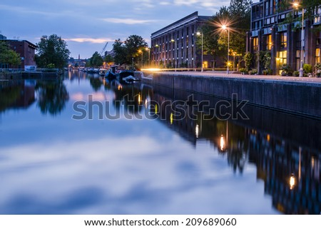 Entrepotdok canal, Amsterdam 3. Shortly after the sun had set on Nieuwevaart canal, I moved to another location nearby- a more sheltered waterway where the reflections were beautiful. - stock photo