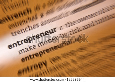 Entrepreneur - a person who organizes and operates a business or businesses, taking on greater than normal financial risks in order to do so. - stock photo