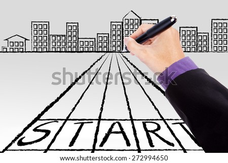Entrepreneur hand use a pen to draw a start line toward a city, symbolizing a guide to start a business - stock photo