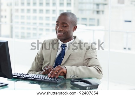 Entrepreneur using a computer in his office