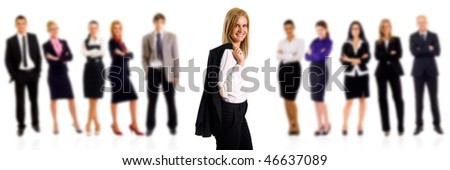 Entrepreneur with coat on shoulder and her team behind her