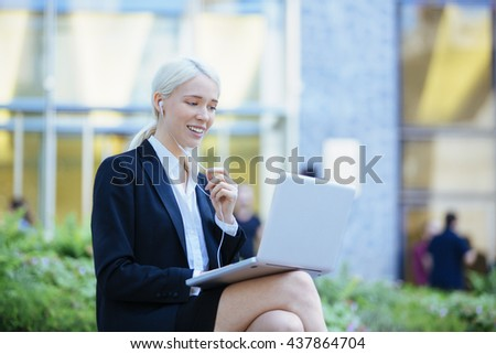 Entrepreneur with Headphones having on-line meeting