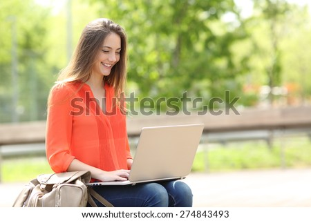 Entrepreneur working with a laptop sitting in a bench in a park