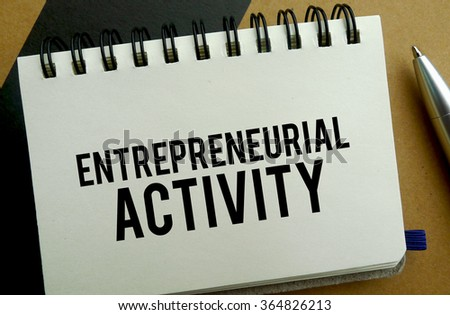 Entrepreneurial activity memo written on a notebook with pen