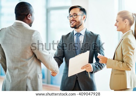 Entrepreneurs meeting and shaking hands - stock photo