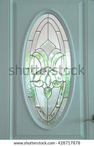 Entry door with glass window closeup - stock photo