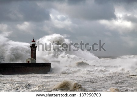 Entry of Douro River harbor during a big storm - stock photo