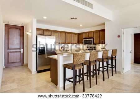 Entry view of kitchen and condominium - stock photo