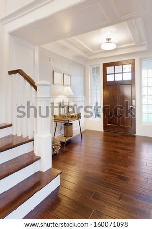 Entryway and Stairs in Luxury Home - stock photo