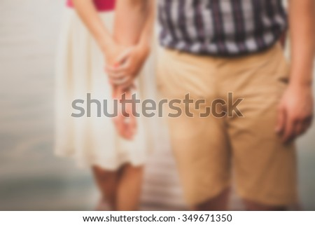Entwined hand of a young couple. A loving young couple. - stock photo