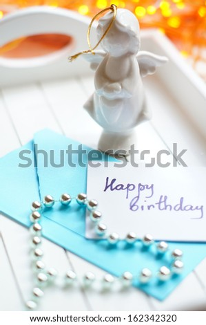 Envelop and note with Happy birthday greeting