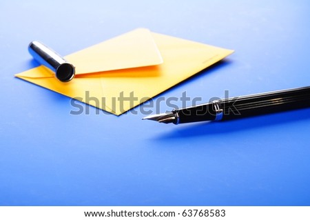 envelop and pen showing mail or communication concept - stock photo
