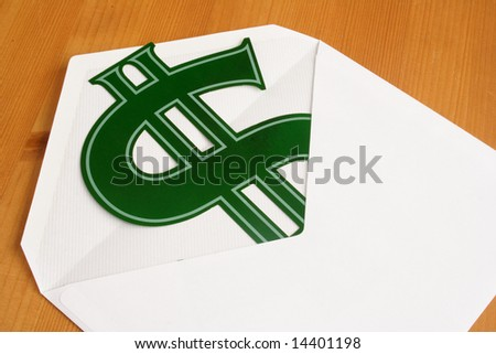 Envelope and dollar symbol on the table - stock photo