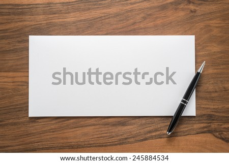 Envelope and pen on wooden background   - stock photo