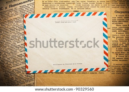 Envelope on aged newspaper