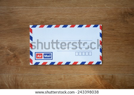 envelope on wooden background - stock photo