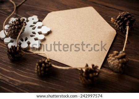 Envelope with Christmas decoration on brown wood table