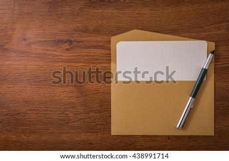 Envelope with pen - stock photo