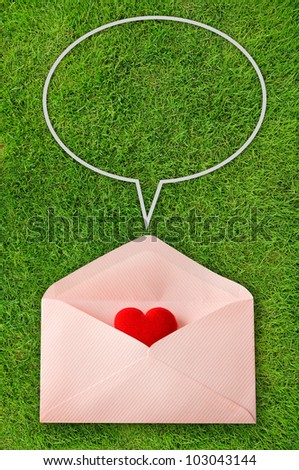 Envelope with red heart and speech bubbles on green background - stock photo