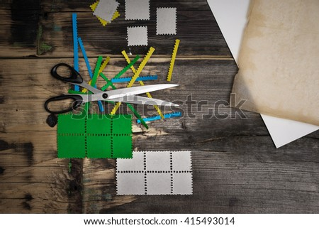 Envelope with stamps and paper for sending messages - stock photo