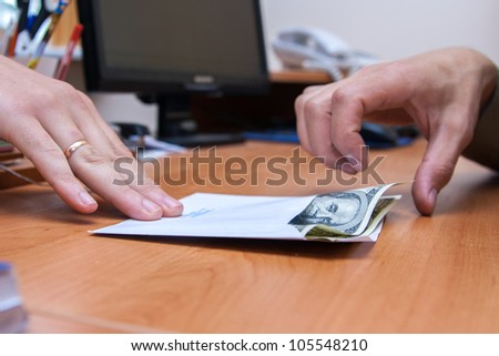 envelope with the money is transferred as a bribe - stock photo