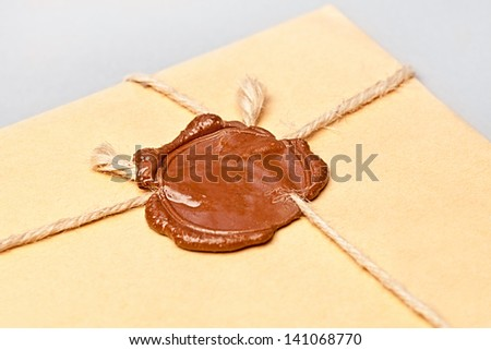 Envelope with wax seal tied with twine - stock photo