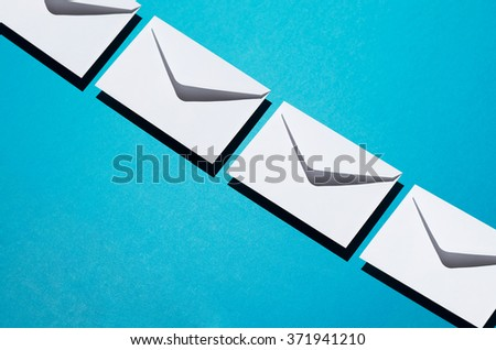 Envelopes pattern over blue background, above view with negative space