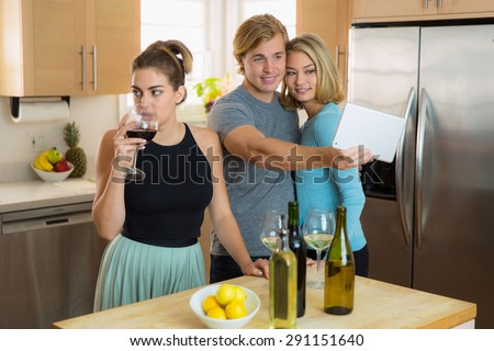 Envious single woman is bored by people at a party jealous about her friend and her date having fun - stock photo