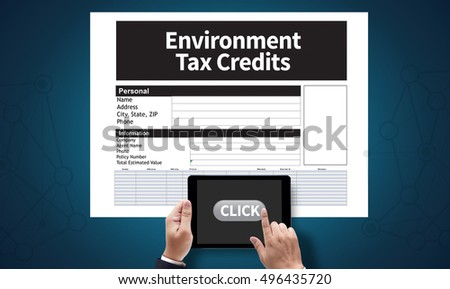 Environment Tax Credits Document Form Credits, on the tablet pc screen held by businessman hands - online, top view