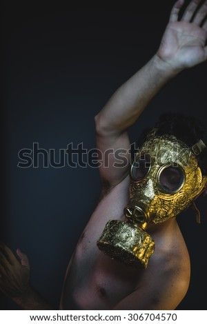 environmental, depression and danger man with golden gas mask - stock photo