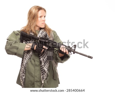 Environmental disaster. Post apocalyptic female survivor holding rifle. - stock photo