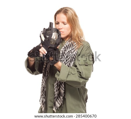 Environmental disaster. Post apocalyptic female survivor putting on gas mask on white background. - stock photo