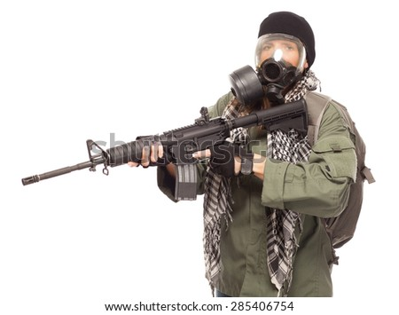 Environmental disaster. Post apocalyptic female survivor with gas mask, rifle and backpack. - stock photo