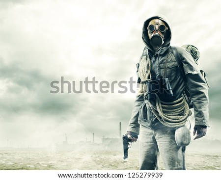 Environmental disaster. Post apocalyptic survivor in gas mask