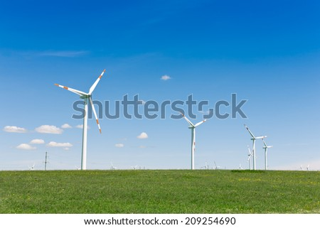 Environmental energy by wind turbines - stock photo