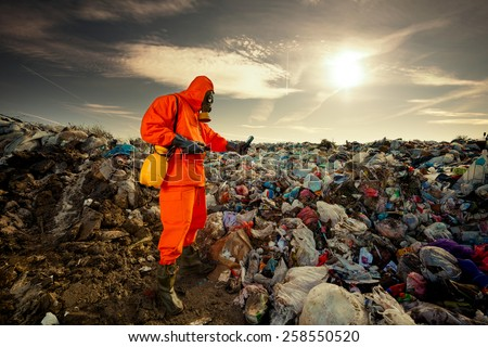 Environmental engineer measuring air pollution on the municipal landfill. - stock photo