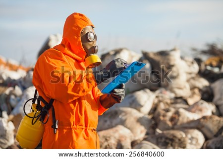 Environmental engineer working on regulation and monitoring of pollution on the municipal landfill. - stock photo