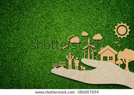 Environmental green energy concept with cardboard cut out on green grass. - stock photo