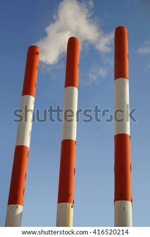 Environmental pollution - Industrial pipes with smoke on a sky background - stock photo