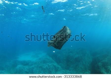 Environmental pollution problem plastic bag in sea - stock photo