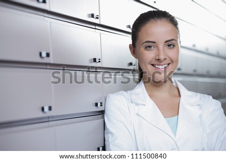 Environmental Portrait of a pharmacist or doctor in pharmacy - stock photo