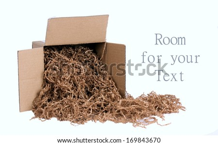 Environmentally Friendly Packing Materials Spilling from a Brown Cardboard Box - stock photo